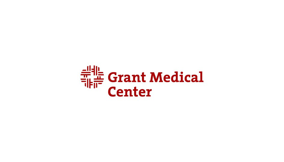 Grant Medical Center: composición geometrizada diferente sobre la cruz médica.